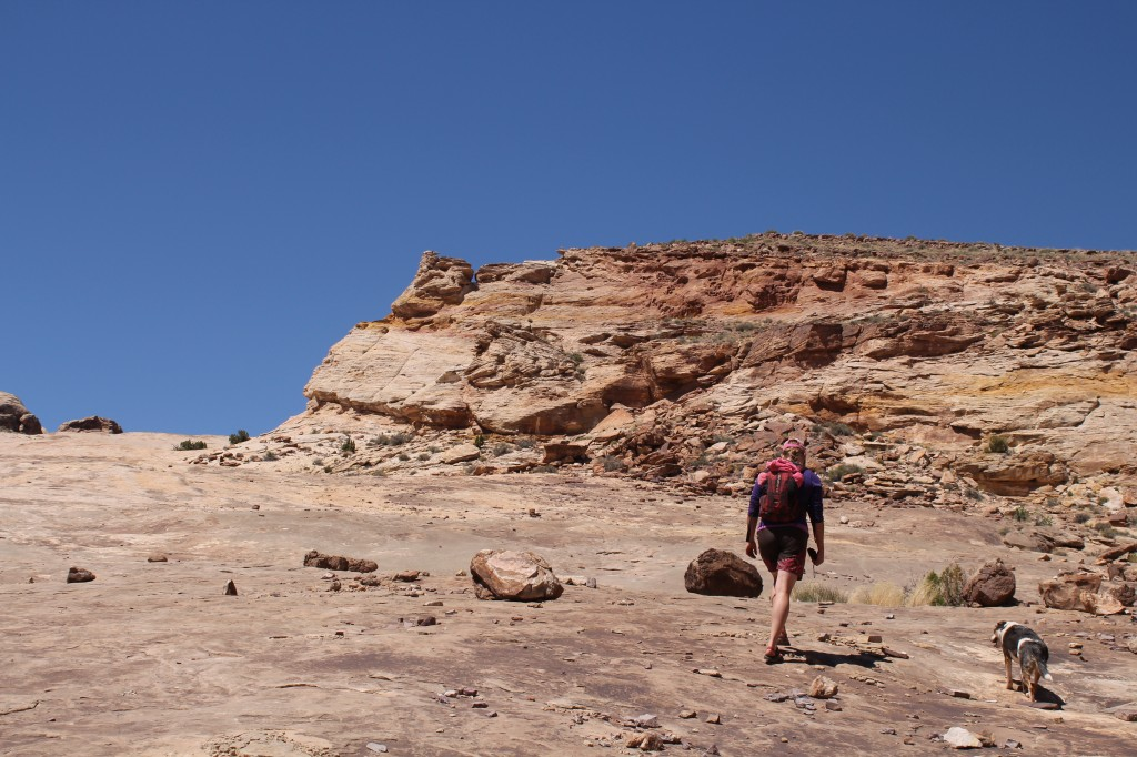 picking our way up the slickrock slope to the right of the main canyon entrance